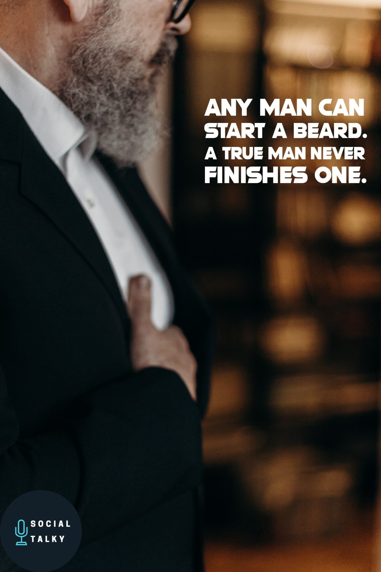man with beard and black suit